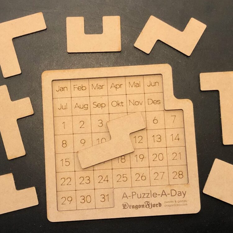 A-Puzzle-A-Day calendar puzzle by DragonFjord. Eight pieces plus calendar frame.